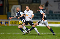 16th March 2021; Dens Park, Dundee, Scotland; Scottish Championship Football, Dundee FC versus Ayr United; Michael Moffat of Ayr United challenges for the ball with Christie Elliott and Max Anderson of Dundee