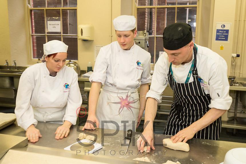 From left Claire Chocholko, Craig Perren and New College lecturer Elliott Richardson