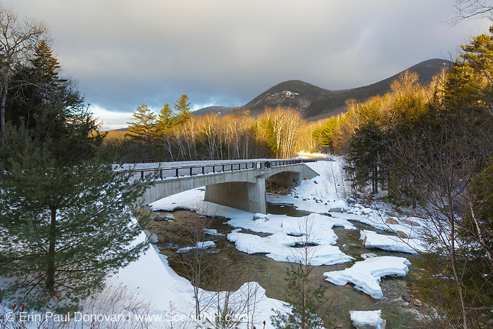 Street bridge, which crosses the East Branch of the Pemigewasset River along the Kancamagus Scenic Byway (Route 112) in Lincoln, New Hampshire on a cloudy winter morning. During the East Branch & Lincoln Railroad era, Trestle No. 4, which marked the start of the Hancock Branch of the railroad, crossed the river in this location. Potash Knob is in the background.