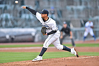 Southern Division pitcher Alejandro Requena (15) of the Asheville Tourists discuss signals during the South Atlantic League All Star Game at Spirit Communications Park on June 20, 2017 in Columbia, South Carolina. The game ended in a tie 3-3 after seven innings. (Tony Farlow/Four Seam Images)