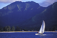 Catamaran sailing in tradewinds with beach and Mount Waialeale in background, on Hanalei Bay, Kauai