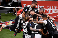 Adrien Rabiot of Juventus celebrates with team mates Rodrigo Bentancur, Federico Bernardeschi, Leonardo Bonucci, Cristiano Ronaldo and Danilo after scoring the goal of 0-1 during the Serie A football match between AC Milan and Juventus FC at stadio San Siro in Milan ( Italy ), July 7th, 2020. Play resumes behind closed doors following the outbreak of the coronavirus disease. <br /> Photo Federico Tardito / Insidefoto