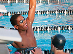 Swimmer raises his arm in victory at CIF SS swim final