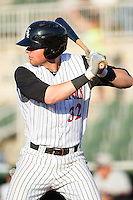 Danny Hayes (32) of the Kannapolis Intimidators at bat against the Hickory Crawdads at CMC-Northeast Stadium on May 18, 2014 in Kannapolis, North Carolina.  The Intimidators defeated the Crawdads 6-5 in 10 innings.  (Brian Westerholt/Four Seam Images)
