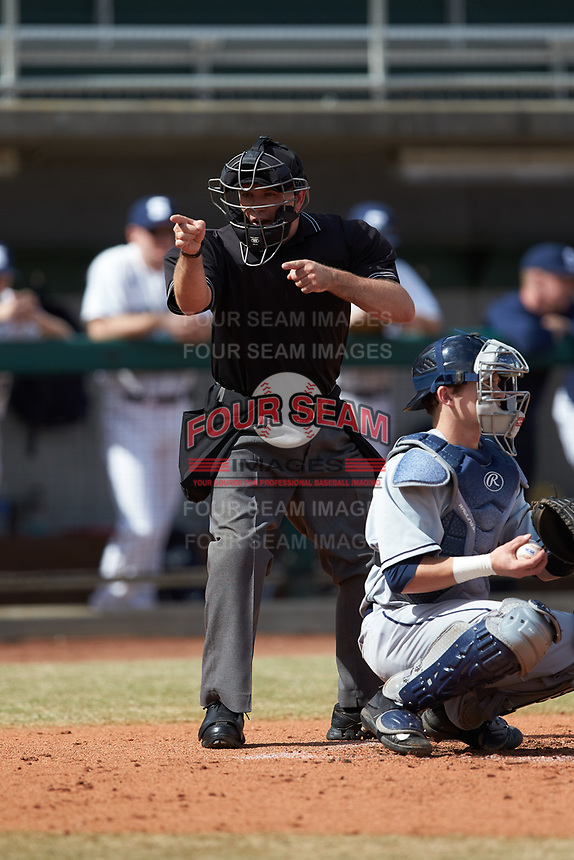 Home plate umpire Reid Churchill makes a strike call during the game between the Xavier Musketeers and the Penn State Nittany Lions at Coleman Field at the USA Baseball National Training Center on February 25, 2017 in Cary, North Carolina. The Musketeers defeated the Nittany Lions 10-4 in game one of a double header. (Brian Westerholt/Four Seam Images)