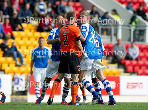 St Johnstone v Dundee United....01.09.12      SPL  .Rowan Vine separates Sean Dillon and Jamie Adams after Willo Floods tackle on Gregory Tade.Picture by Graeme Hart..Copyright Perthshire Picture Agency.Tel: 01738 623350  Mobile: 07990 594431