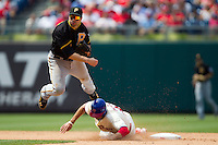 Pittsburgh Pirates  second baseman Neil Walker #18 turns a double play during the Major League Baseball game against the Philadelphia Phillies on June 28, 2012 at Citizens Bank Park in Philadelphia, Pennsylvania. The Pirates defeated the Phillies 5-4. (Andrew Woolley/Four Seam Images)..