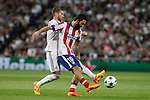 Real Madrid's Sergio Ramos (L) and Atletico del Madrid´s Arda Turan during quarterfinal second leg Champions League soccer match at Santiago Bernabeu stadium in Madrid, Spain. April 22, 2015. (ALTERPHOTOS/Victor Blanco)