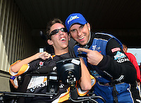 Sept. 30, 2012; Madison, IL, USA: NHRA top fuel dragster driver T.J. Zizzo (right) with Kyle Keck during the Midwest Nationals at Gateway Motorsports Park. Mandatory Credit: Mark J. Rebilas-