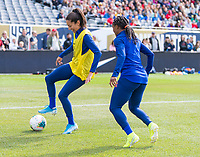 CHICAGO, IL - OCTOBER 5: Christen Press #23 of the United States is defended by Crystal Dunn #19 at Soldier Field on October 5, 2019 in Chicago, Illinois.