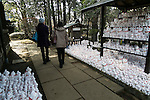 Visitors walk past thousands of Maneki-Neko figurines on display at Goutoku Temple on January 26, 2016 in Tokyo, Japan. The temple and the surrounding area is well known for its massive collection of Maneki-Neko, literally beckoning cats. The cats  are a common Japanese charm thought to bring good luck to the owner. They are often displayed at the entrance to shops and restaurants but Goutoku Temple goes one further and displays over 1000 cats throughout its ground. (Photo by Rodrigo Reyes Marin/AFLO)
