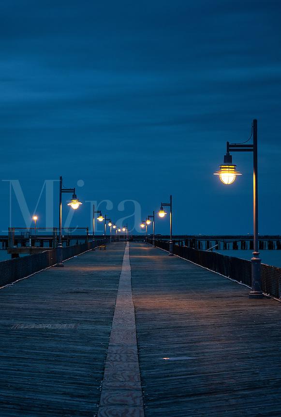 Boardwalk pier at night. Cape Helopen State Park, Delaware, USA