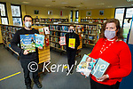 Niamh Doyle, Ann Waldron and Alan Andrei stand with their books of the year at the Tralee Library on Tuesday.