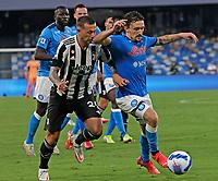 11th September 2021; Maradona Stadium, Naples, Italy; Serie A football, SSC Napoli versus Juventus  FC: Mario Rui of Napoli  and Federico Bernardeschi of Juventus challenge for the ball