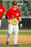 """Kale Kiser (9) of the Kannapolis Intimidators sports his Championship Belt for being named the """"Organization Position Player - Hardest Worker"""" by the strength and conditioning coaches prior to the South Atlantic League game against the Lexington Legends at CMC-Northeast Stadium on July 29, 2013 in Kannapolis, North Carolina.  The Intimidators defeated the Legends 10-5.  (Brian Westerholt/Four Seam Images)"""