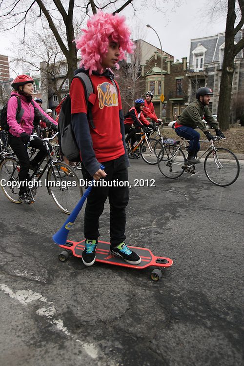 Montreal (QC) CANADA - April  1st, 2012 - Quebec students on strike againt tuition fees increase,walk on bicycle, skates, roller-skate