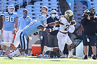 CHAPEL HILL, NC - NOVEMBER 14: Christian Beal-Smith #26 of Wake Forest is chased by Cam'Ron Kelly #9 of North Carolina during a game between Wake Forest and North Carolina at Kenan Memorial Stadium on November 14, 2020 in Chapel Hill, North Carolina.