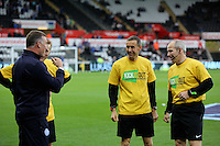 Pictured: Match officials and referees with yellow Kick It Out anti-racism campaign t-shirts<br />