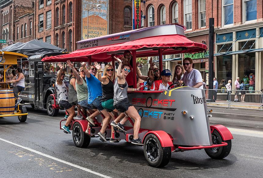 Sprocket Rocket party bike travels down Broadway, Nashville, Tennessee, USA.