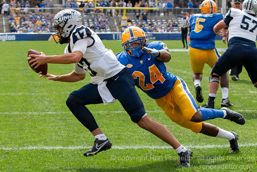 Pitt linebacker Phil Campbell (24) tackles New Hampshire quarterback Bret Edwards in the endzone for a safety. The Pitt Panthers defeated the New Hampshire Wildcats 77-7 at Heinz Field, Pittsburgh, Pennsylvania on September 25, 2021.