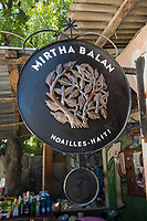 Haiti, Port-au-Prince. Noailles, the Village of Iron Craftsmen in Croix-des-Bouquets, an old sugar plantation, is now Haiti's iron center with 70 workshops, nearly 300 artists and impacts 7000 homes. The artists create iron work sculptures from oil drums. Mirtha Balan, 53, has been working as an artist doing this for 30 years and is one of the few women women artists working in the metal business. It helped raise her five children who also work in the business now. MR