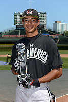 Jacob Gatewood of Redwood High School in Visaila, California holds the home run derby champion trophy before the Under Armour All-American Game on August 24, 2013 at Wrigley Field in Chicago, Illinois.  (Mike Janes/Four Seam Images)