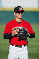 Jose Cardona (8) of the Hickory Crawdads warms up in the outfield prior to the game against the Kannapolis Intimidators at L.P. Frans Stadium on April 23, 2015 in Hickory, North Carolina.  The Crawdads defeated the Intimidators 3-2 in 10 innings.  (Brian Westerholt/Four Seam Images)
