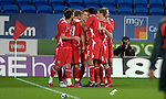 International Friendly match between Wales and Scotland at the new Cardiff City Stadium : Wales' Aaron Ramsey is hugged by his team mates after scoring a goal.