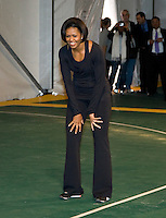 First Lady Michelle Obama waits for the ball at a passing drill during a US Soccer Foundation clinic held at City Center in Washington, DC.