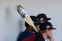 Salt River Rafters first baseman Pavin Smith (44), of the Arizona Diamondbacks organization, holds a paddle with a photo of hitting coach Shelley Duncan (18) on it during an Arizona Fall League game against the Mesa Solar Sox at Sloan Park on October 30, 2018 in Mesa, Arizona. Salt River defeated Mesa 14-4 . (Zachary Lucy/Four Seam Images)