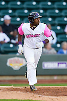 Courtney Hawkins (10) of the Winston-Salem Dash hustles down the first base line against the Wilmington Blue Rocks at BB&T Ballpark on April 20, 2013 in Winston-Salem, North Carolina.  The Dash defeated the Blue Rocks 4-2 in game one of a double-header.  (Brian Westerholt/Four Seam Images)