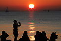 People watch first sun rise of 2018 along Tokyo Bay