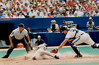 1990 FILE PHOTO - ARCHIVES -<br /> <br /> Too late, Boston's Tom Brunansky slides into home before Jays catcher Greg Myers can apply the tag in eighth inning yesterday. Boston won 1-0.<br /> <br /> 1990<br /> <br /> PHOTO :  Erin Comb - Toronto Star Archives - AQP