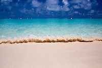 Crystal clear waters break the shore on Michaelmas Cay