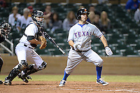 Surprise Saguaros first baseman Brett Nicholas (19), of the Texas Rangers organization, at bat in front of catcher Dustin Garneau during an Arizona Fall League game against the Salt River Rafters on October 15, 2013 at Salt River Fields at Talking Stick in Scottsdale, Arizona.  Surprise defeated Salt River 9-2.  (Mike Janes/Four Seam Images)