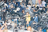 Television news crews wait during Vice President Joe Biden speaks at the Democratic National Convention at the Wells Fargo Center in Philadelphia, Pennsylvania, on Wed., July 27, 2016.