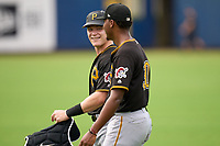 FCL Pirates Black catcher Henry Davis (32) walks to the bullpen with starting pitcher Cristopher Cruz (30) before a game against the FCL Rays on August 3, 2021 at Charlotte Sports Park in Port Charlotte, Florida.  Davis was making his professional debut after being selected first overall in the MLB Draft out of Louisville by the Pittsburgh Pirates.  (Mike Janes/Four Seam Images)