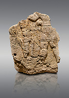 Picture & image of Hittite relief sculpted orthostat stone panel of Long Wall Limestone, Karkamıs, (Kargamıs), Carchemish (Karkemish), 900 - 700 B.C. Anatolian Civilizations Museum, Ankara, Turkey. The short-skirted figure with a dagger at the waist holds the gazelle from its hind legs<br /> <br /> On a gray background.