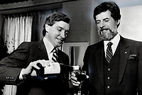 1983 FILE PHOTO - ARCHIVES -<br /> <br /> A toast: Ontario Industry Minister Gordon Walker, left, and his Quebec counterpart Rodrigue Biron toast the conclusion of closed-door talks on trade issues yesterday with - what else? - Ontario wine.<br /> <br /> PHOTO :  Keith  BEATY  - Toronto Star Archives - AQP