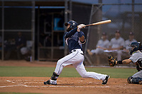 AZL Padres 2 right fielder Blinger Perez (14) follows through on his swing during an Arizona League game against the AZL Padres 1 at Peoria Sports Complex on July 14, 2018 in Peoria, Arizona. The AZL Padres 1 defeated the AZL Padres 2 4-0. (Zachary Lucy/Four Seam Images)