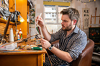 BNPS.co.uk (01202 558833)<br /> Pic: MaxWillcock/BNPS<br /> <br /> Pictured: Jonathan Hodgson fletching in his studio in Ilminster, Somerset.<br /> <br /> A skilled fletcher has set up a business making artistic and competition arrows after being inspired by Lord of the Rings.<br /> <br /> Jonathan Hodgson adopts Medieval techniques to fashion them out of sustainable timbers, using precious stones for the arrow head.<br /> <br /> The feathers are humanely collected from turkey or geese and bound on with silk in a process which takes several days.<br /> <br /> The 37 year old, from Ilminster, Somerset, made his first arrows out of bamboo and slate as a child living in a farmhouse with plenty of land.