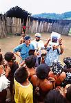 "Photographer Art Wolfe explains his ""Tribes"" book project to Yanomami Indians, Parima Tapirapeco National Park, Venezuela"