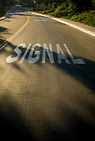 Signal Ahead sign on road