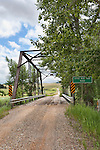 Gravel Forest Service road leaves U.S. Highway 12 at the junction with Montana 141, crossing the Little Blackfoot River near Avon, Montana.