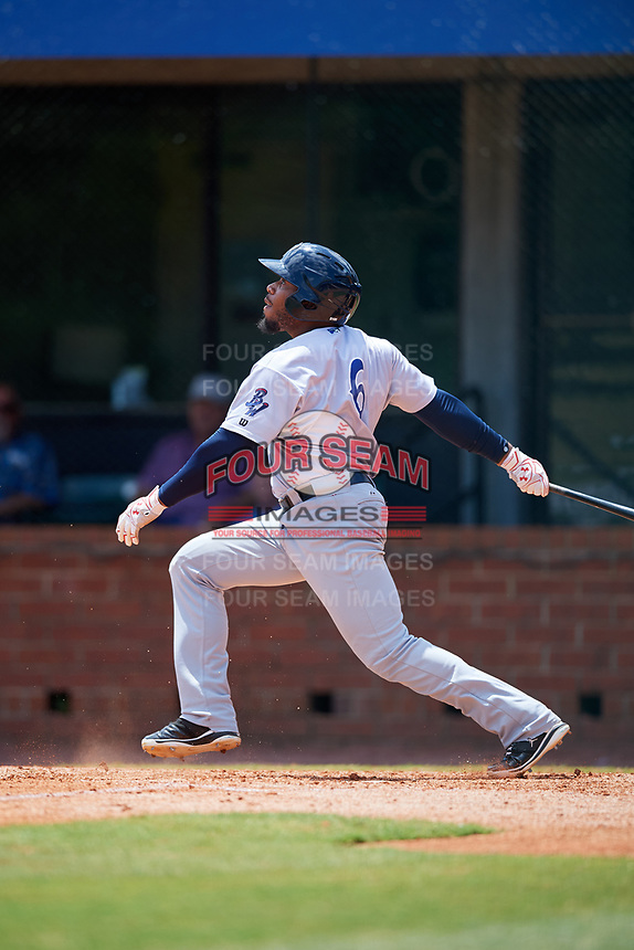 Pensacola Blue Wahoos left fielder Leon Landry (6) follows through on a swing during a game against the Mobile BayBears on April 26, 2017 at Hank Aaron Stadium in Mobile, Alabama.  Pensacola defeated Mobile 5-3.  (Mike Janes/Four Seam Images)