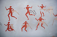 Close up of a recontructed fresco of an original found at Catalhoyuk. The depicted men are wearing what scolars believe were leopard skin costumes. Painted by Mutlu Gundiler. Reconstructed houses, 7500 BC to 5700 BC, Catalyhoyuk Archaeological Site, Çumra, Konya, Turkey