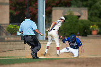 Michael Turconi (4) (Wake Forest) of the High Point-Thomasville HiToms applies a late tag as Matthew Suggs (1) (UNC Wilmington) of the Martinsville Mustangs slides into third base while home plate umpire Brian Pitss looks on at Finch Field on July 26, 2020 in Thomasville, NC.  The HiToms defeated the Mustangs 8-5. (Brian Westerholt/Four Seam Images)