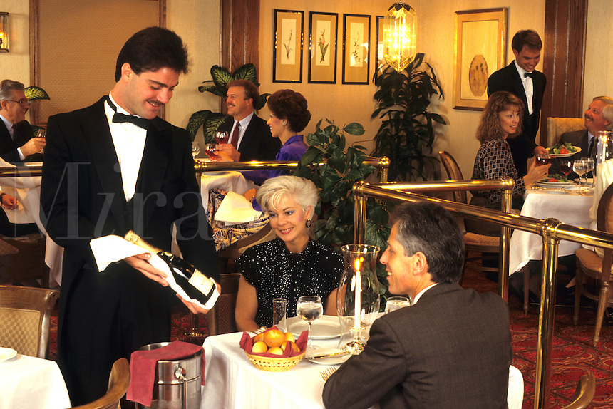 Couple selecting a bottle of wine in a upscale restaurant