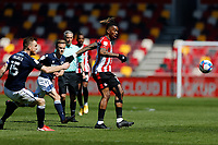 17th April 2021; Brentford Community Stadium, London, England; English Football League Championship Football, Brentford FC versus Millwall; Ivan Toney of Brentford passing the ball into midfield