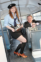 """NO FEE. 20/10/2010. Vintage CIE Double Decker Bus Makes One Last Stop . Beautiful 'conductor' Jane Kendlin and The Lord Mayor, Cllr Gerry Breen are pictured in full conductor's uniform to mark the launch oftwo new books on CIE Buses in the 1970's and 1980's, avintage CIE double decker bus, outside the Mansion House on Dawson Street, Dublin.he coffee table books have been published by PRC Publications, a new transport publications company based in Dublin, and feature a miscellany of photographs of Irish buses and street scenes in both rural and urban locations, taken by Ed O'Neill from mid 1970 to mid 1980. A self-confessed """"bus nut"""", O'Neill has compiled the two books which will appeal to both enthusiasts and the general public alike. Urban street scenes, including traffic on Dublin's Grafton Street, will remind readers of a time long gone when traffic regulations were far more relaxed and beautiful buildings stood tall, many of which are sadly no longer in existence. The books, 'CIE Buses in the 1970s and 80s - Double Deckers' and 'CIE Buses in the 1970s and 80s - Single Deckers'are priced at EUR25.00 per book (or both books for EUR45.00) and are available from Mark's Models branches or online atwww.prcpublications.com. Picture James Horan/Collins Photos"""